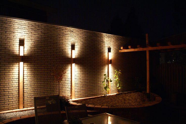 "custommade lighting on douglas fir plank in the garden, by: ""HANS"". (www.hansknepper.nl)"
