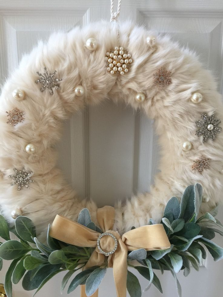 White Faux Fur Christmas Wreath.  Snowflake brooches, 1940's glass pearls, 1940's velvet ribbon, lambs ear, and tiny lights. DIY
