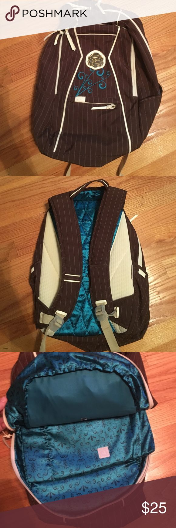 Ogio book bag Used but good condition.  Ogio blue and brown back pack.  Multiple pockets, pocket for laptop and place to pull headphones through. Ogio Bags Backpacks