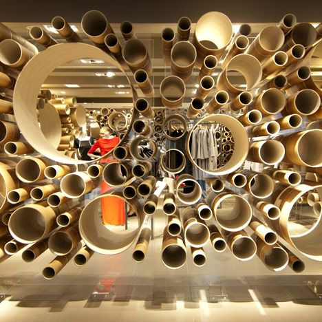 Architects Grimshaw have completed an installation for London department store John Lewis that's made of suspended cardboard tubes. The tubes vary in length and sit in the circular holes cut from two vertical sheets of clear acrylic. The design will debut at John Lewis' Oxford Street shop for two months before moving around the UK to