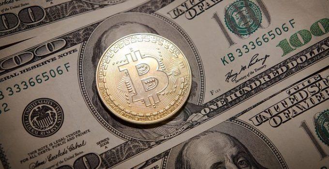in q tel bitcoin