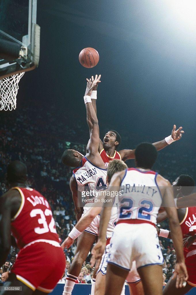 Houston Rockets' Ralph Sampson #50 shoots over Washington Rockets' Rick Mahorn #44 during a game at Capital Centre circa 1984 in Washington, D.C..