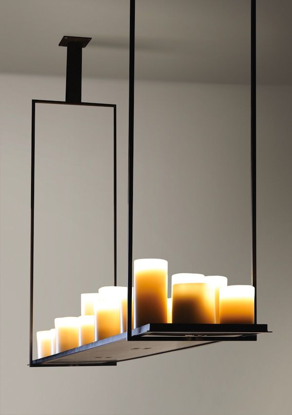 [design by Kevin Reilly] - If it were glass, could you see the light better on the table? And if the candles were those cup shapes made of wax, would they then not drip?