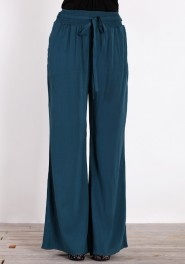 Try some non-denim.  These easy wide-leg pants would be 10x more comfortable than jeans. Wear with a crop sweater