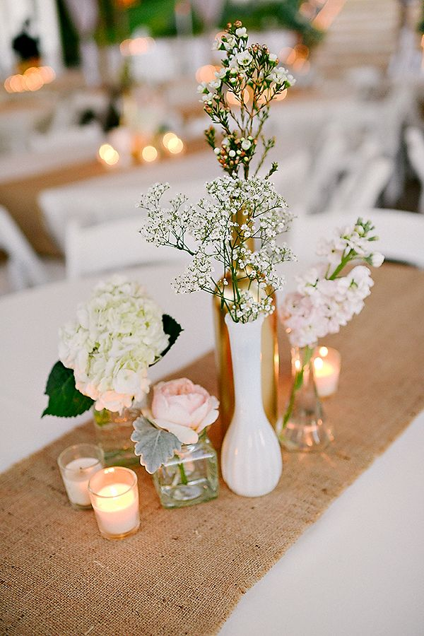 cute and simple floral centerpiece ideas - I like the gold painted wine bottle hiding in the back.
