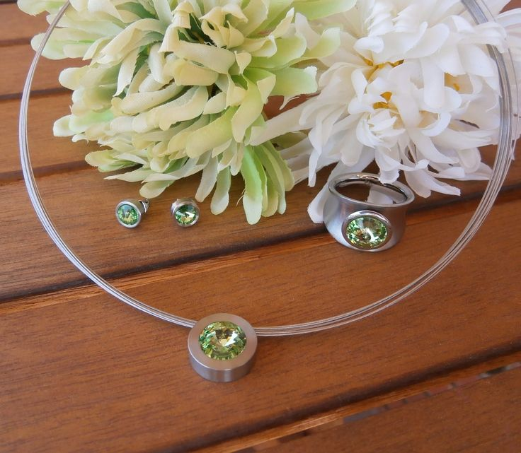 Set of ring, earrings and pendant in stainless steel and swarovski® crystal green peridot.