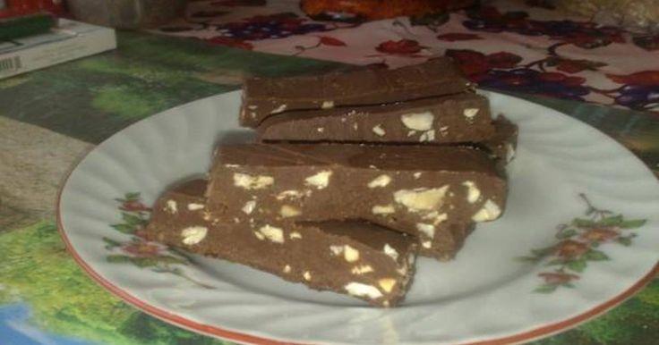 Εξαιρετική συνταγή για Μπάρες σοκολάτας με ταχίνι και μέλι νηστίσιμο. Η συνταγή είναι από την εκπομπή του Παρλιάρου «Γλυκές αλχημείες» στις 20-3-10. Πολύ εύκολο να φτιαχτεί, ότι πρέπει για την περίοδο της νηστείας και όχι μόνο! Λίγα μυστικά ακόμα Δεν είχα τσέρκι σ' αυτές τις διαστάσεις, γι' αυτό χρησιμοποίησα ένα τάπερ μακρόστενο. Η συμβουλή του Παρλιάρου στην περίπτωση αυτή (που δεν έχουμε τσέρκι 18Χ18) είναι να αφήσουμε λίγο το μείγμα να σφίξει και να το απλώσουμε σε μια επιφάνεια...