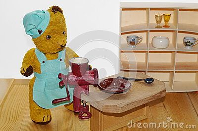 Teddy bear Morulet in kitchen. The bear is bought from the supermarket 50 years ago.