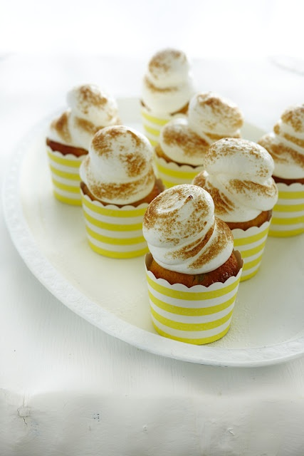 Coconut and passionfruit cupcakes with meringue frosting    http://thefooddept.blogspot.com.au/