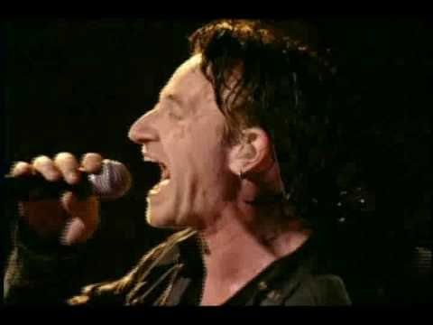 """U2 - In A Little While... Bono plays tribute to Joey Ramone who died of lymphoma at New York-Presbyterian Hospital on April 15, 2001, after a seven-year battle. He was reportedly listening to the song """"In a Little While"""" by U2 when he died. This was during U2's Elevation Tour, and from that point on during shows Bono would introduce the song as a tune that was originally about a lovestruck hangover but that Joey turned it into a gospel song."""