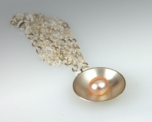 Pendant: Sterling silver, round pearl, hand fabricated.