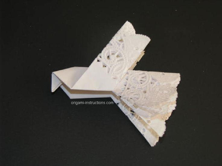 Origami dove made out of an 8 inch circle doillie.