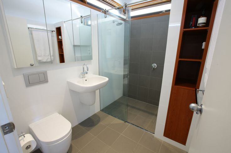 WILLIAMSTOWN BATHROOM Designed by Russell Henderson Built by SmarterBathrooms  Storage without vanity, wall hung basin, concealed cistern WC