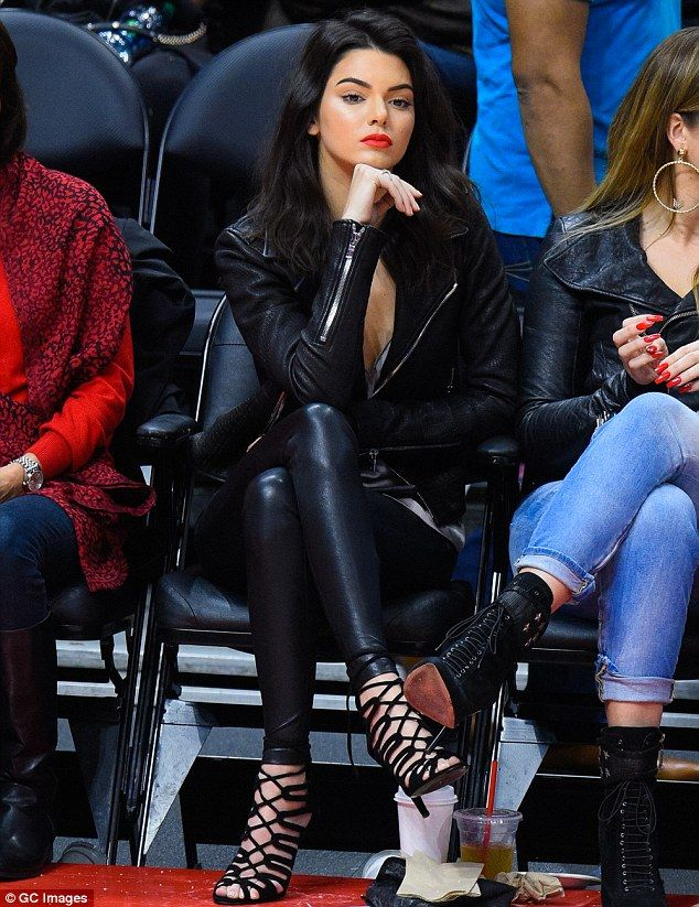 Kendall Jenner. Fashion forward: The model covered up her enviable figure in a fitted pair of leather leggings and matched her trousers with a leather jacket on top