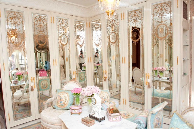 A closet for an old school glamour girl.  Etched mirrors on closet doors.