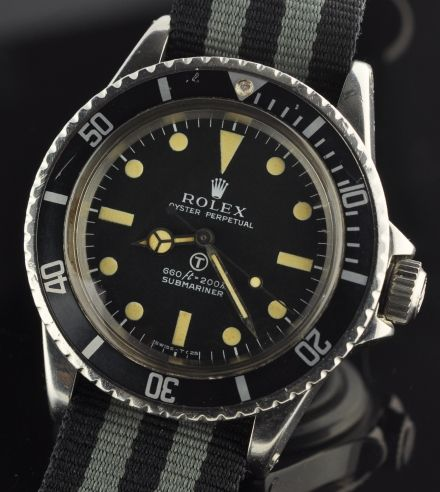 """EXTREMELY RARE and desirable 1973 ROLEX 5513 MILSUB having the original """"T"""" dial with matching ORIGINAL hands. The stainless steel case is all ORIGINAL with correct British military markings and case back serial numbers inside. The serial number indicates a date of 1973."""