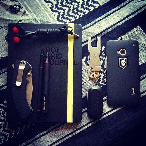 cadetartemis:      My boyfriend @Andrew Warren's current #EDC: #Kershaw Rake, HTC earbuds, #Rotring 600 pencil, #Space-TEC, Dot Grid journal, The Clip keychain tool, #HTC One phone