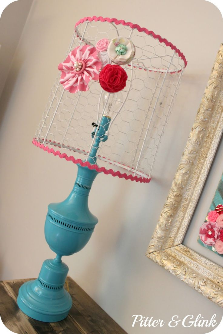 I am going gaga over this chicken wire lamp shade and the thrift store redo of this lamp!! I'm thinking the little kids room.    PitterAndGlink: {Craft Room Redo: Vintage Lamp Makeover}