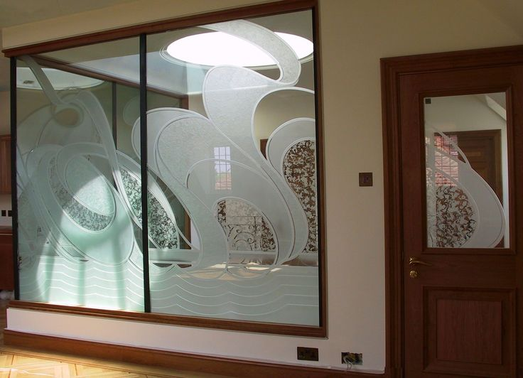 Etched Glass Wall Panels With A Flowing Pattern That Continues Into The Door Panel