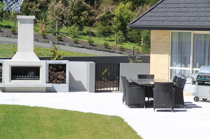 Lifestyle block with outdoor social area. The ground has been leveled with terraced gardens. The fireplace creates an inviting focal place for the outdoor space.
