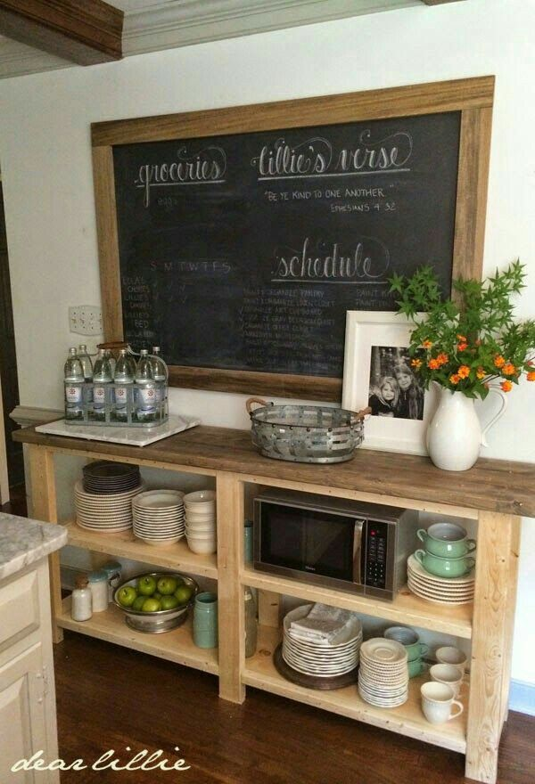 Maybe one or 2 floating shelves above a GIANT chalkboard