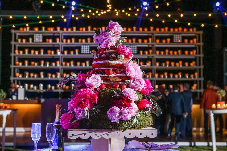 Rustic Wedding Inspirations. Naked wedding cake with forest fruits and fuchsia garden roses.