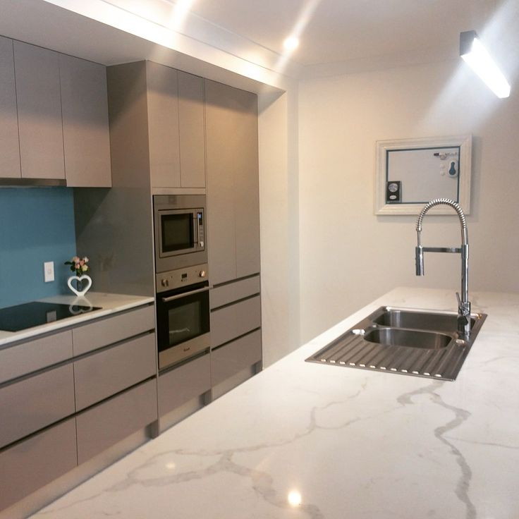 The Carrara marble look without the price tag! #engineeredquartz #greykitchen #kitchenrenovation #brisbanekitchen #brisbanekitchensolutions #cararramarblelook