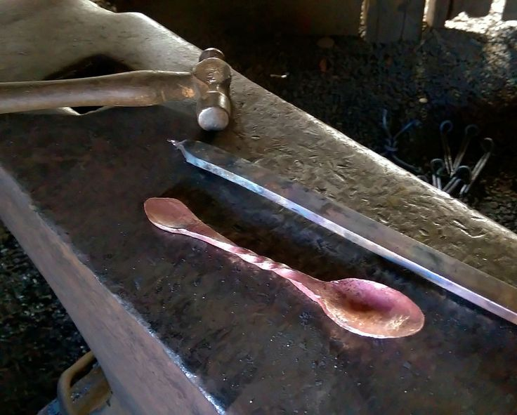 Wayne Wagstaff, Metal artist. This is the Copper Tea Spoon just after I finished forging it, the copper bar laying next to it is the piece it came from.#blacksmith #metal #copper #blacksmithing
