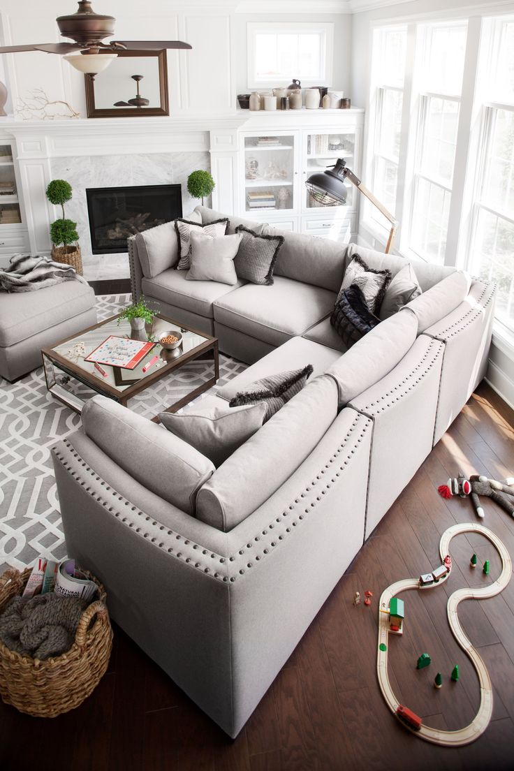White Couch, love seat, fireplace, basket and rug