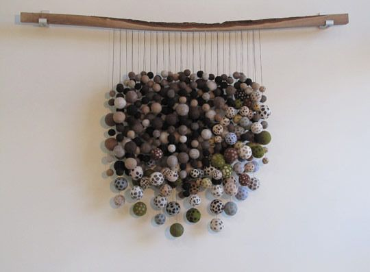 I really like this fiber sculpture.. it feels both primitive and modern, and I kind of just want to stick my face in it.