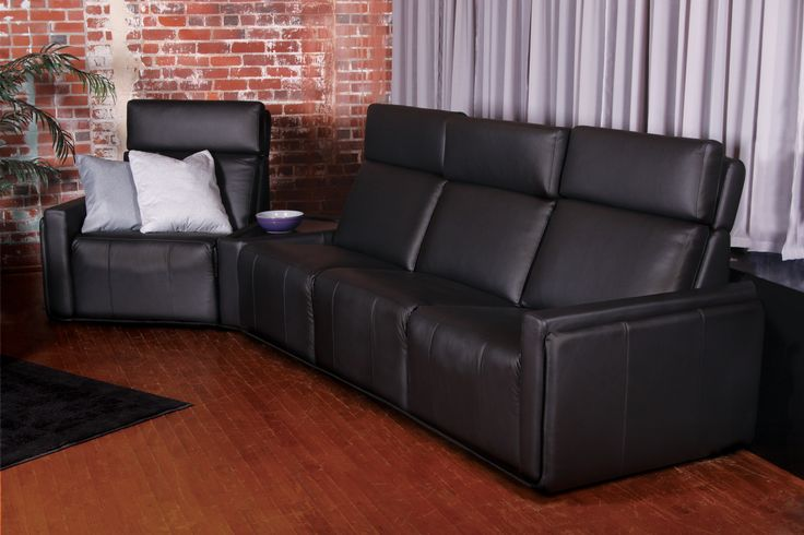 NEW Alto black leather sectional with angular table. Retractable head-rest.Motorized reclining mechanism. Made in Canada