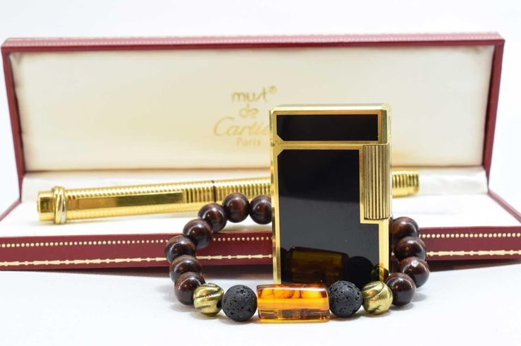 Stunning Mens beaded Bracelet, made with 10mm dark brown Wood beads, two 10mm Black Lava beads and two bronze 10mm metal beads. In the middle there is one large 20 X 10mm Natural Baltic Amber bead, and in the back one 12 X 7mm carved camel bone bead.
