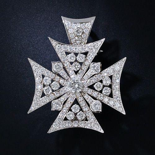 Diamond Maltese Cross - Late 20th Century - Just shy of 9.00 carats of bright-white,  round brilliant-cut diamonds (including a .90 carat center stone) join forces to create this dynamic and dazzling Maltese cross brooch and pendant. The gracefully concaved brooch is designed with a removable bale (loop) which allows it to be worn as a brooch as well as a necklace.