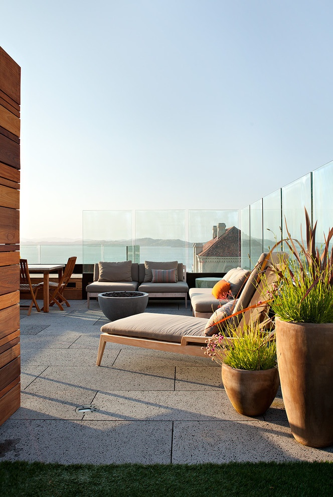 Keep your view with glass dividers- Combat wind factor and keep kids safe. love a fire pit.