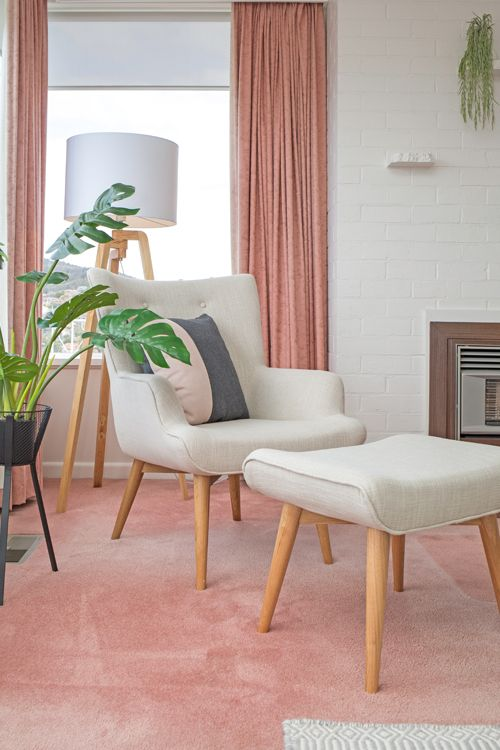 Scandi wingback armchair with matching foot stool, monsteria plant and pink carpet