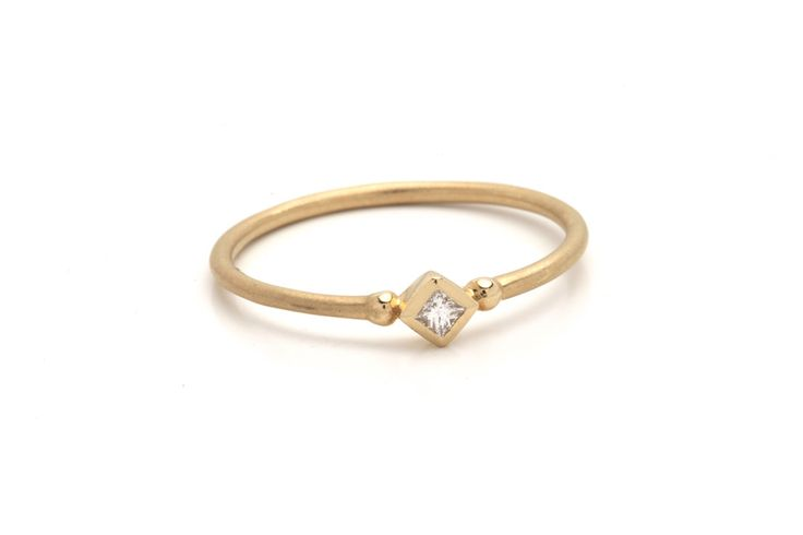 SANA ring in 14 k set with a princess cut diamond. U can wear it for any occasion.