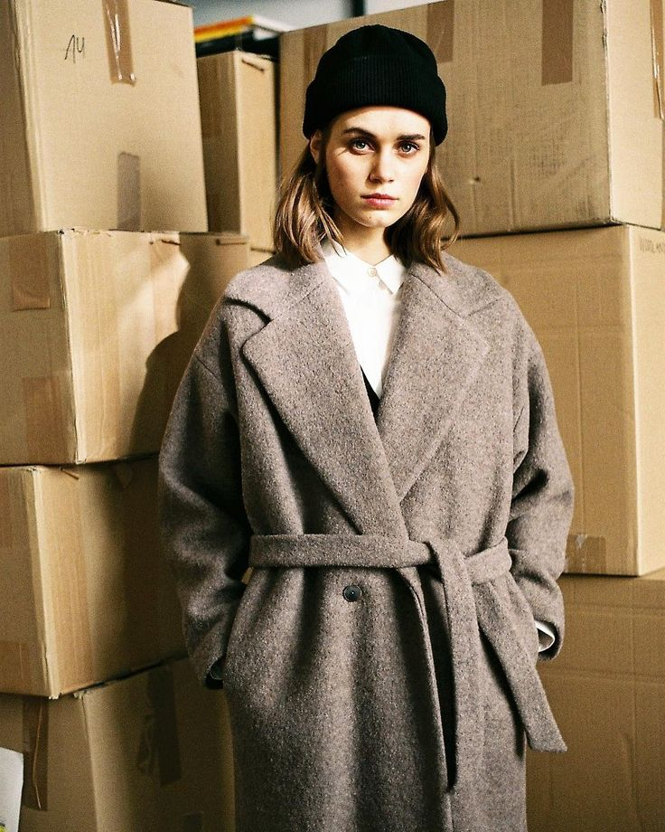 Elis sporting our Chaya coat in #taube.  Now available online an in stores. #akindofguise #akog #madeingermany