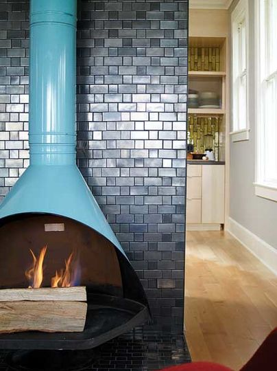 Living room: for fireplace area: dark but shiny subway tiles with wood burner in accent colour.