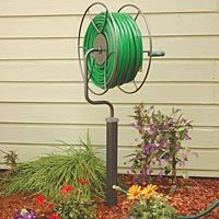 """Full Rotation Free-Standing Hose Swivel Reel, Anti-Rust Steel    The unique patented swiveling turret design can rotate 360 degrees and hold up to 200' of 5/8"""" hose, making it capable of delivering water anywhere within a total coverage area of over 3 acres!"""