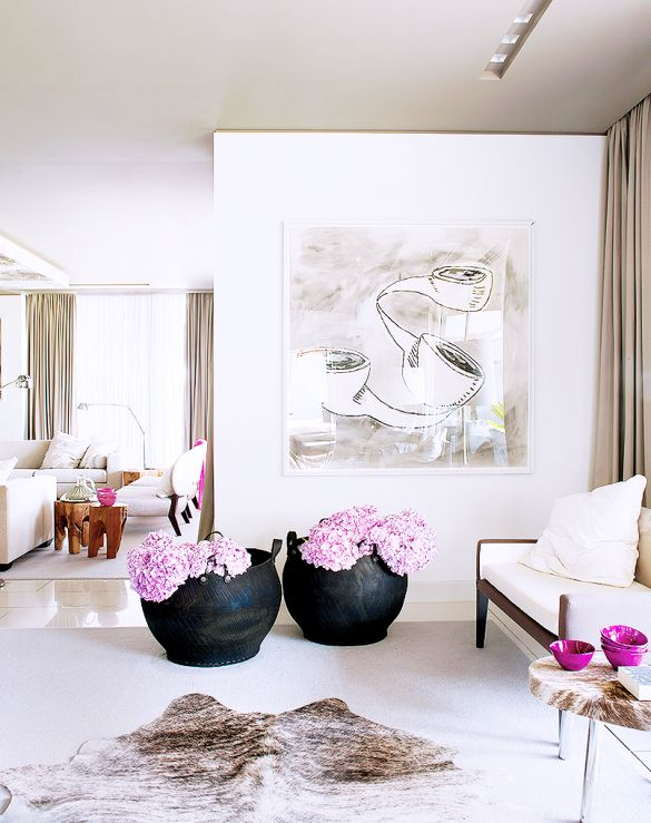 Neutrals Go Glam in This Spectacular Lisbon Home// cow hide, pink hydrangeas