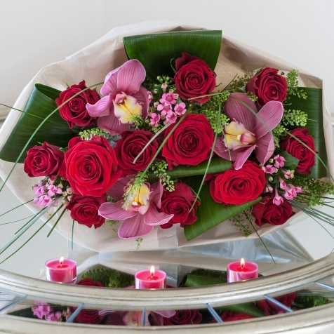 L Amour - Win this stunning bouquet of luxury, large headed Red Naomi roses is combined with stunning pink cymbidium orchid heads. Surrounded with red roses, bouvardia and luxurious foliage. #nextflowers