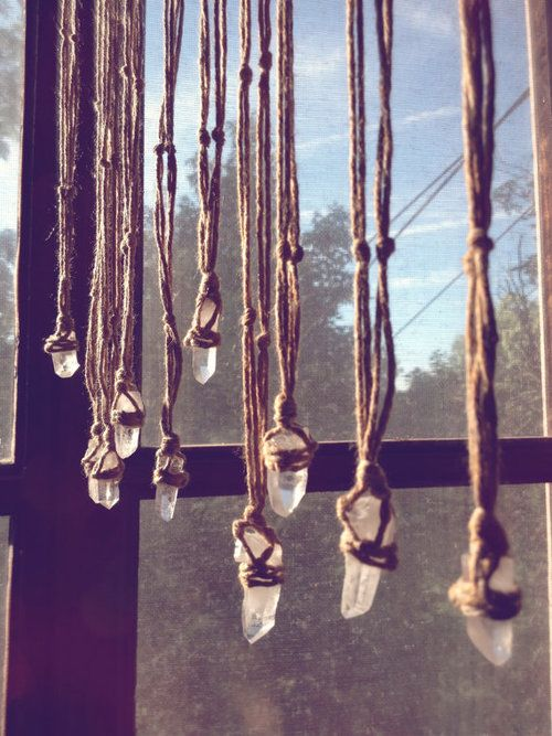 Natural rock crystals hanging from the window to fill the house with good energy.