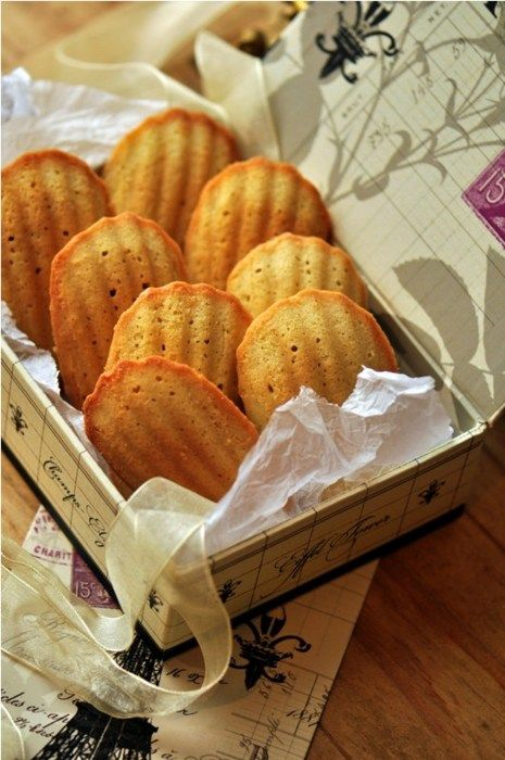 "LES MADELEINES~ French butter cake bakes in shell shaped molds that give the cookie it's distinctive shape. ~ made famous by Marcel Proust in ""À la recherche du temps perdu"" ""Remembrance of Things Past"" he famously evokes the Madeleine dipped in tea."