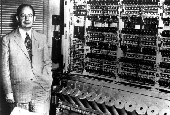 <> 1944: Engineer John von Neumann stands with the Harvard Mark I, an electromechanical computer.