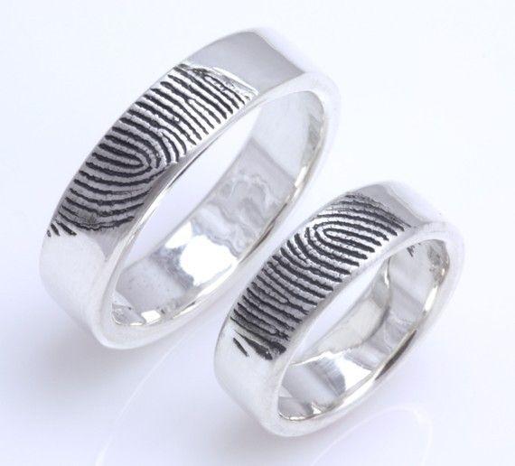 Custom fingerprint his and her wedding bands... Definitely incorporating fingerprints into our rings.
