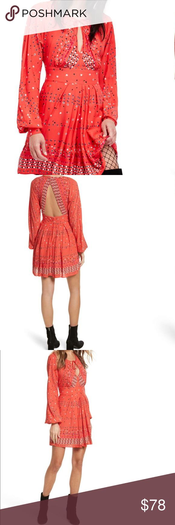 ☀️ Free People Mini Dress ☀️ Gorgeous coral-colored dress that embodies everything about Free People - embracing the spirit of romance with a rock n' roll edge. This dress features a colorful print and a triangular keyhole back define this versatile fit-and-flare minidress boasting plenty of boho charm. Free People Dresses