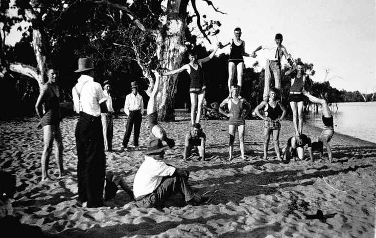 Lake Lonsdale, a group of men in bathing costume and forming a pyramid, c1930.
