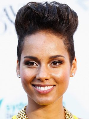 ALICIA KEYS  Dec 10 2013  Alicia Keys created height by pulling her pixie completely up, highlighting the shaved sides