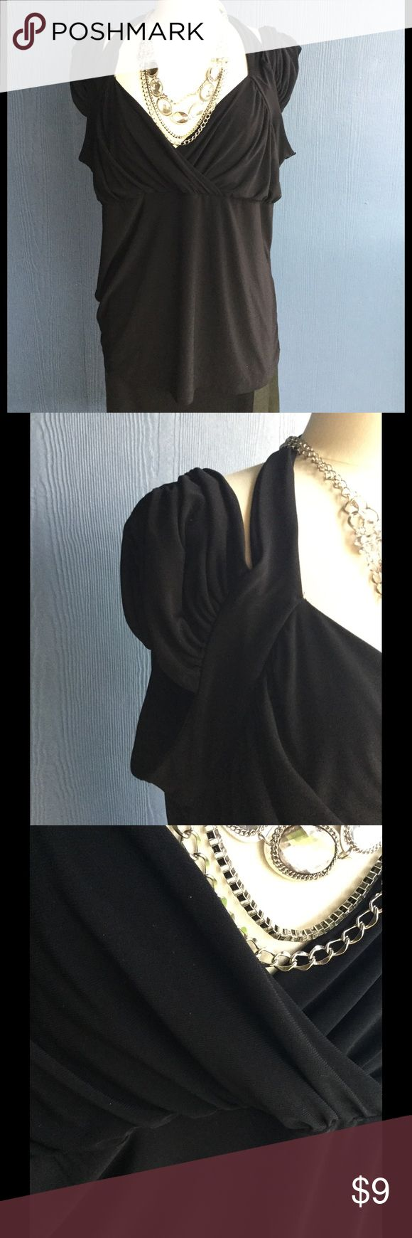 Black short sleeve top Polyester stretch knit blouse. Has cap,sleeves and V neck front. Dots Tops Blouses