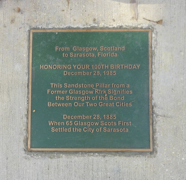 Plaque describing the Corinthian Column gifted to the City of Sarasota at the corner of Main St. & Gulfstream Ave at the point of landing in 1885 of the Scot founders of the City of Sarasota